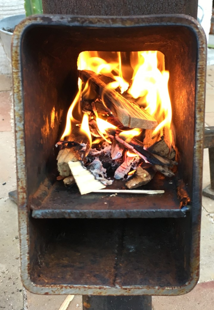 The fire within the small but mighty rocket stove.
