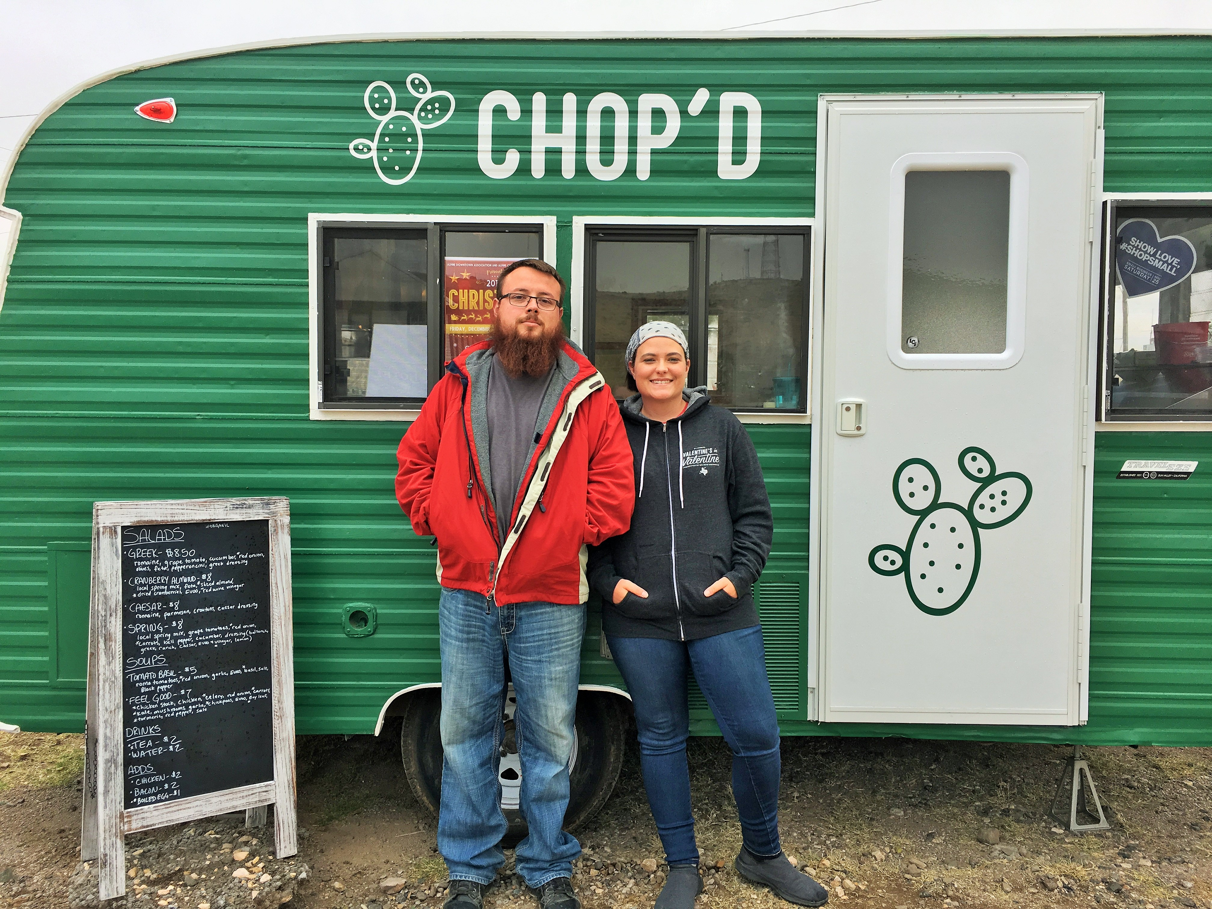 Emily and Jonathan Herrera in front of Chop'd.