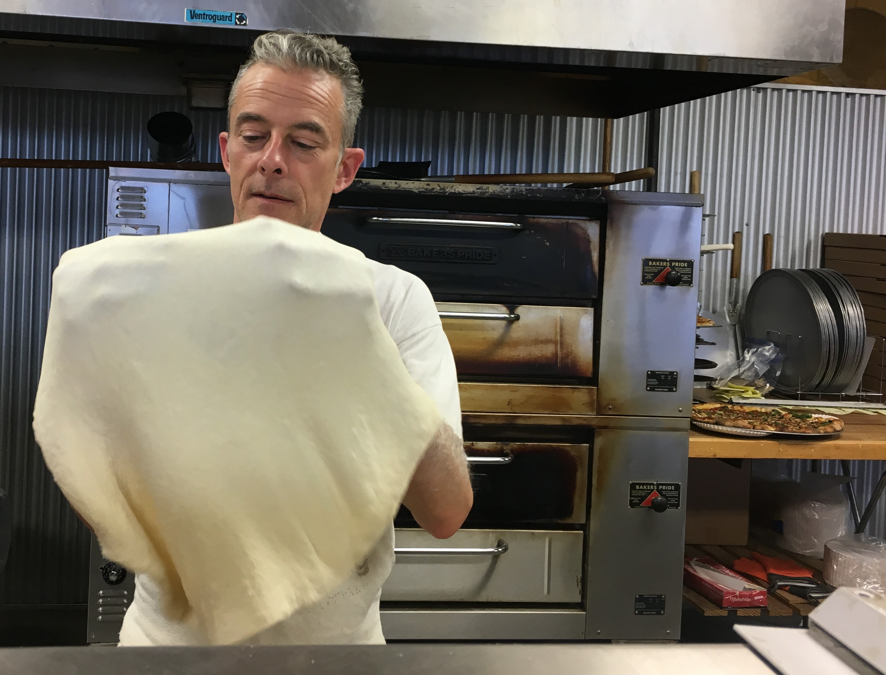 Ronnie hand-strecthes every pizza dough.