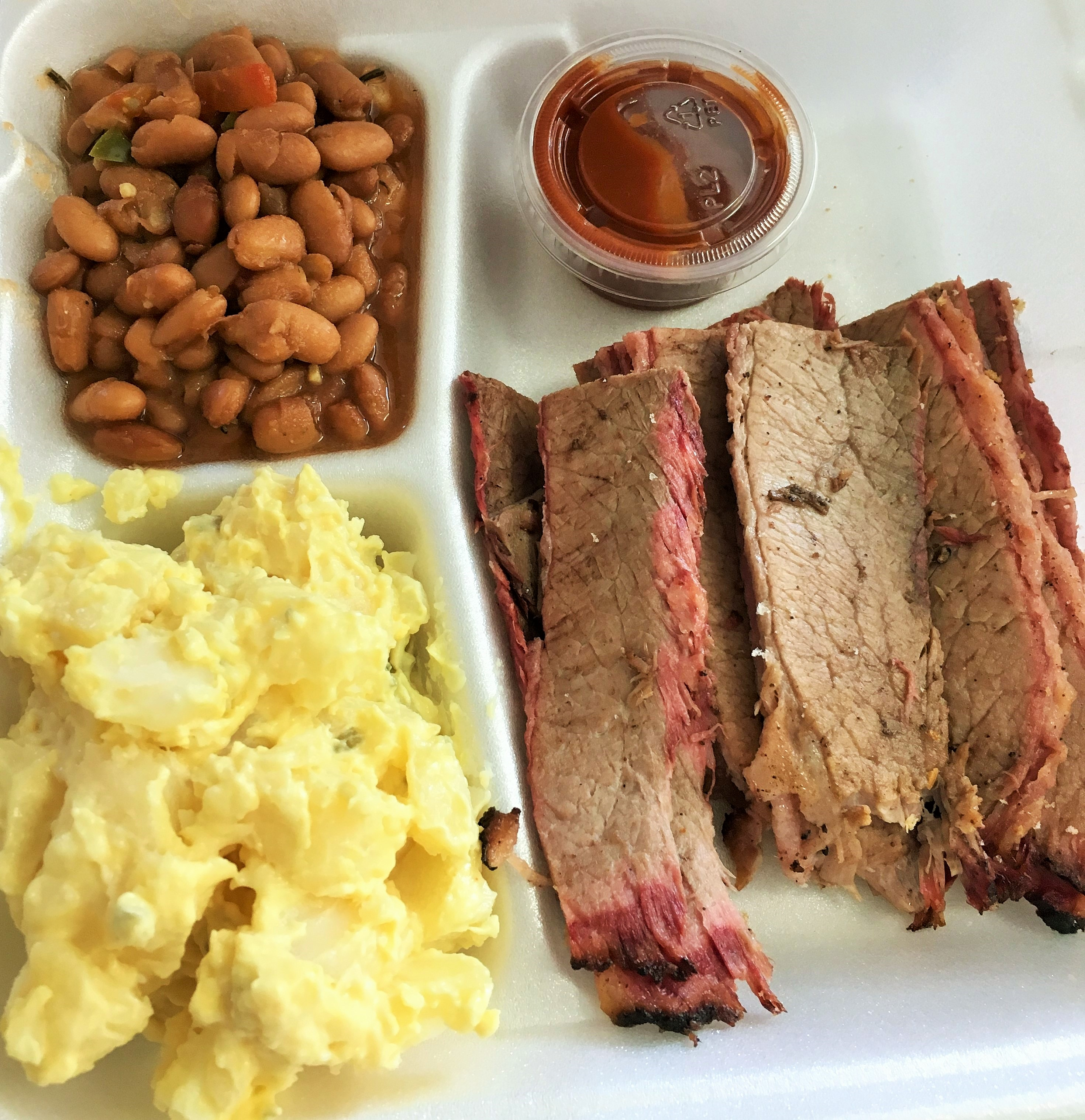 Brisket plate with pinto beans and mustard potato salad
