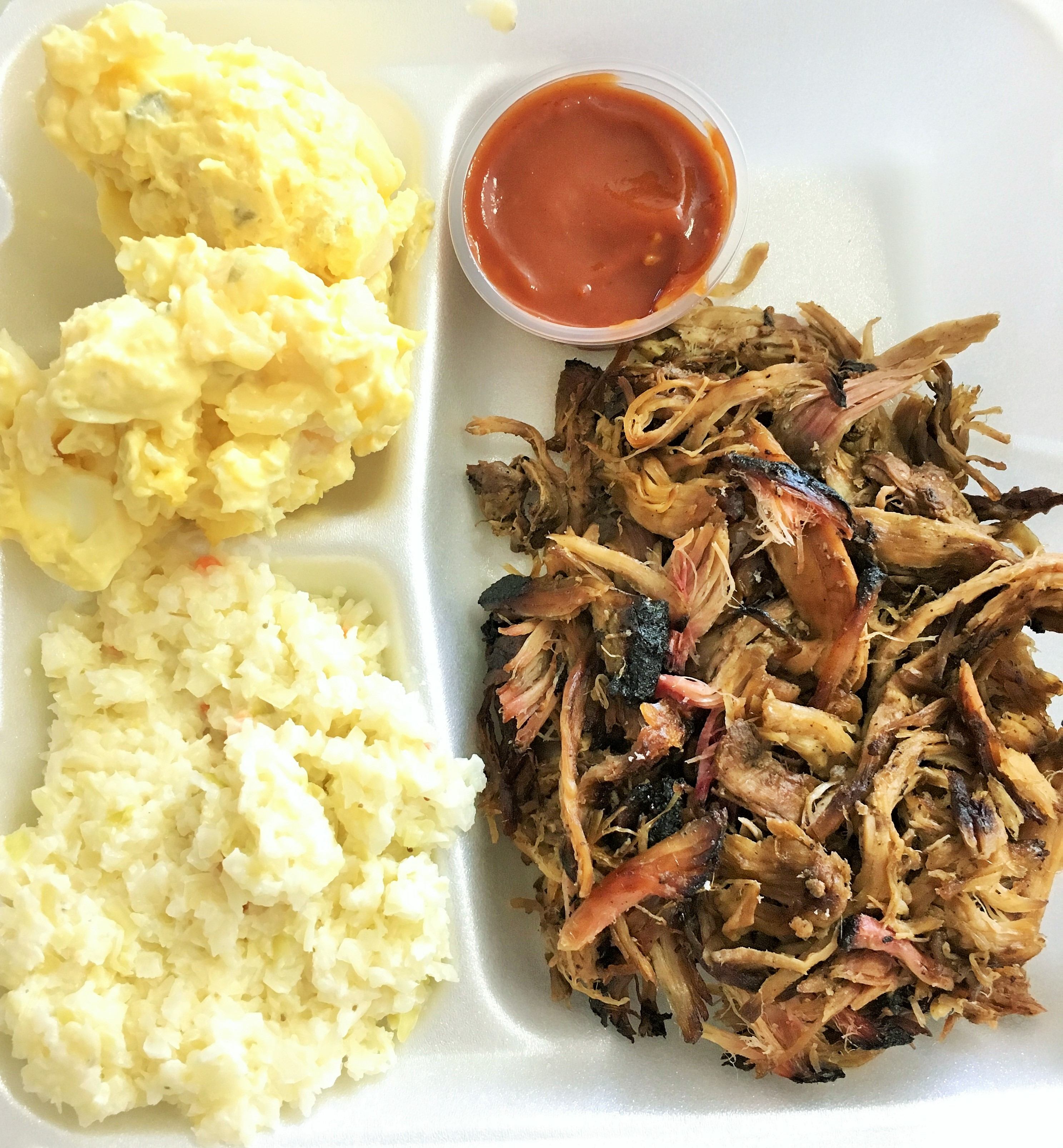 Pulled pork plate with mustard potato salad and coleslaw