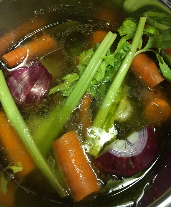 Veggies and water added to roasted ox tails