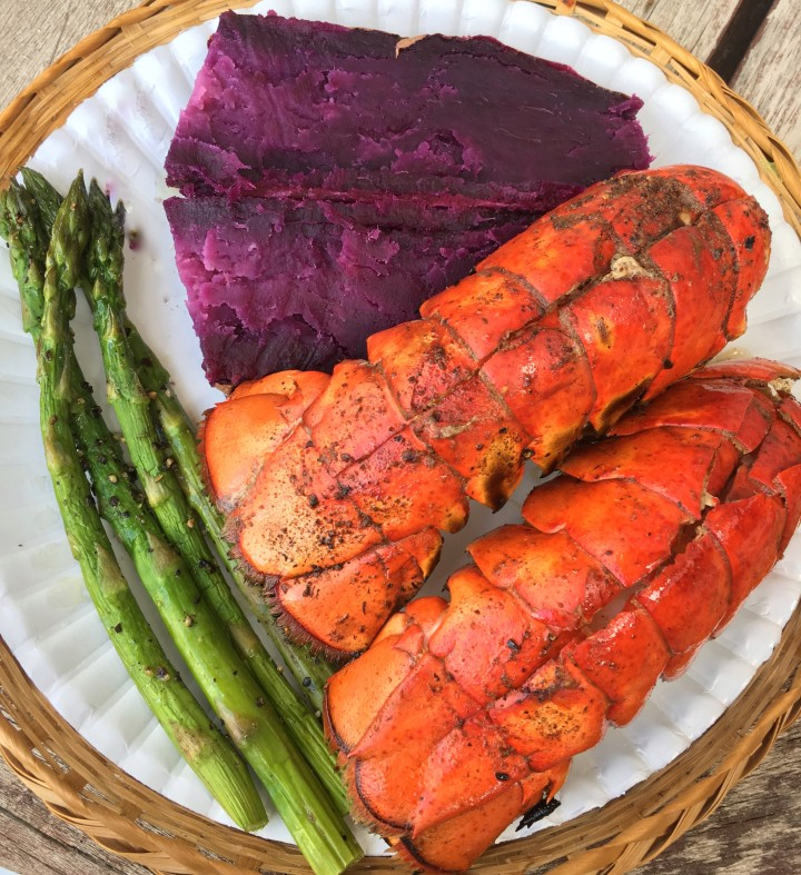 Grilled lobster tails, roasted asparagus and baked purple sweet potato made for a colorful dinner.