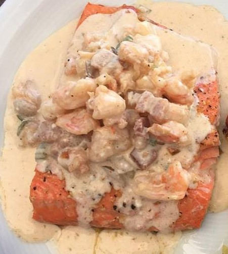 Wild caught Alaskan Sockeye Salmon with Cajun Creamy Shrimp sauce... it doesn't get much better than this.