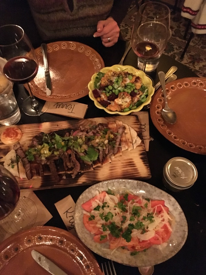 A small portion of the food we were served. Salads and flatbread with beef.