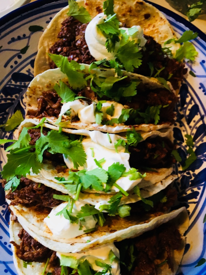 My Carne Adovado tacos, with sour cream and cilantro.