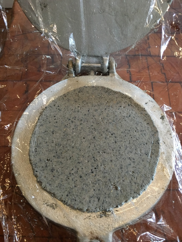 Using an old but not antique tortilla press for this batch.
