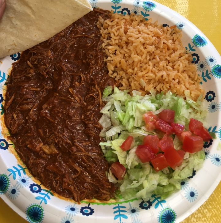 Chicken mole plate served with four warm corn tortillas. Deliciousness.