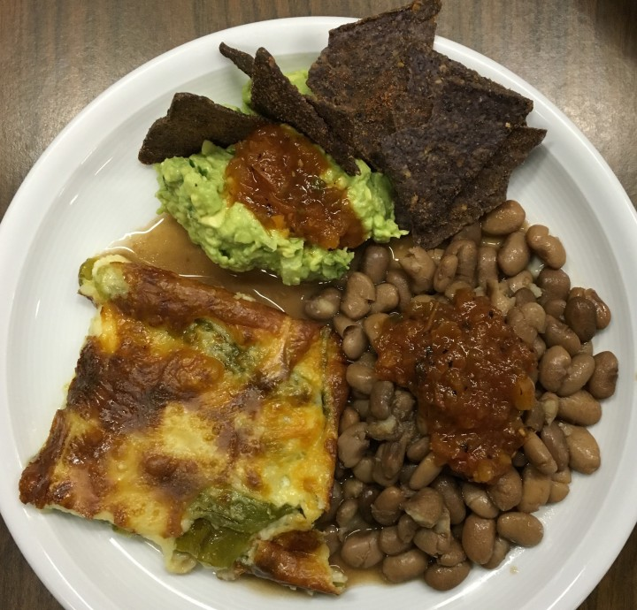 How I serve Baked Chile Rellenos - with guacamole, chips, salsa and homemade pinto beans.